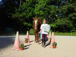 "Kimberly sets out through the ""carrot patch"" with her pony."