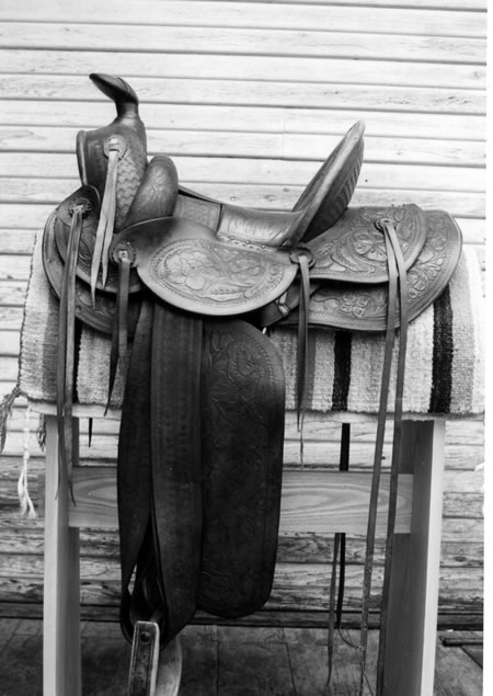 Saddle from unknown maker. Note tubelike rolls, not removable circa early 20th century.