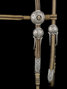 Drain created the sterling silver buckles, tips and conchas for this two-tone browband headstall by TCAA rawhide braider Pablo Lozano. The piece appeared in the 2014 TCAA exhibition. COURTESY NATIONAL COWBOY MUSEUM