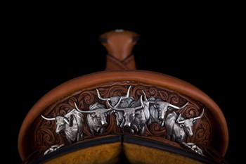Bean decorated his 2012 TCAA saddle's cantleback with a Longhorn herd in sterling silver. The saddlemaker typically handles his own silverwork. Photo courtesy NATIONAL COWBOY & WESTERN HERITAGE MUSEUM