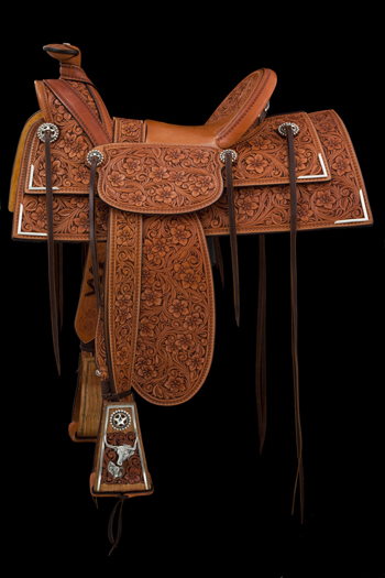 Bean's 2012 TCAA saddle honored the Great Plains trail drives of the 1870s. The half-seat saddle has period Joseph Stamstag rigging, and is built on a modified Visalia tree. Photo courtesy NATIONAL COWBOY & WESTERN HERITAGE MUSEUM