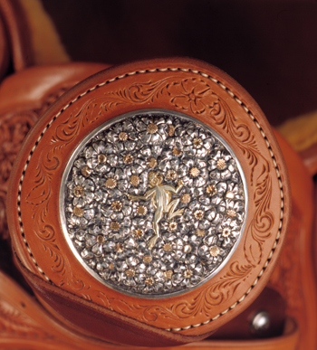 On this horn cap Scott Hardy created for a Cary Schwarz saddle, a 14-karat green gold frog travels across a bed of silver and gold wildflowers. The saddle appeared in the 2000 TCAA exhibition. PHOTO COURTESY NATIONAL COWBOY & WESTERN HERITAGE MUSEUM